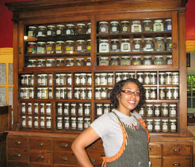 Alicia-Before-the-Apothecary-Cupboard-at-the-Lucky-Mojo-Curio-Company