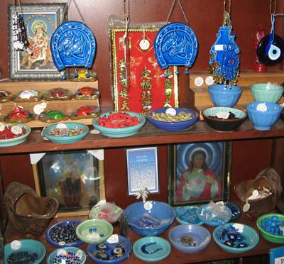 Anti-Evil-Eye-Amulets-Shelves-at-Lucky-Mojo-Curio-Company