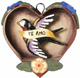 Heart-Retablo-with-Bird-Tattoo-Design-at-Lucky-Mojo-Curio-Company